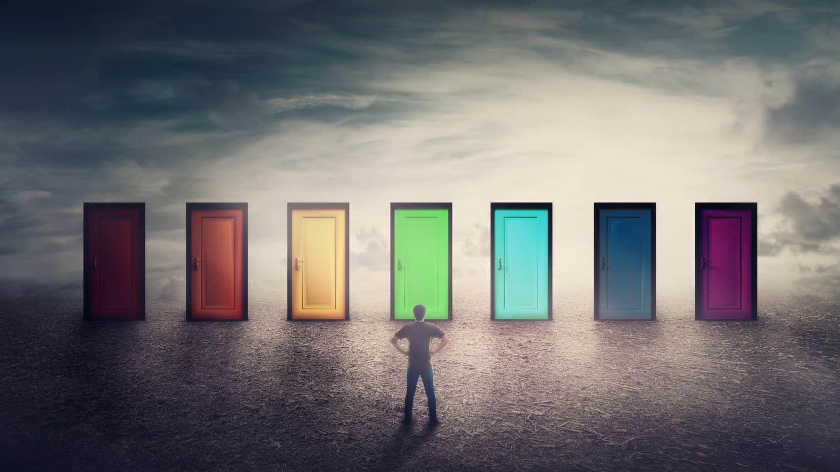Man standing in front of a series of colored doors. He has to make a choice.